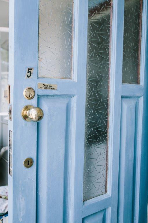 Room 5 blue door