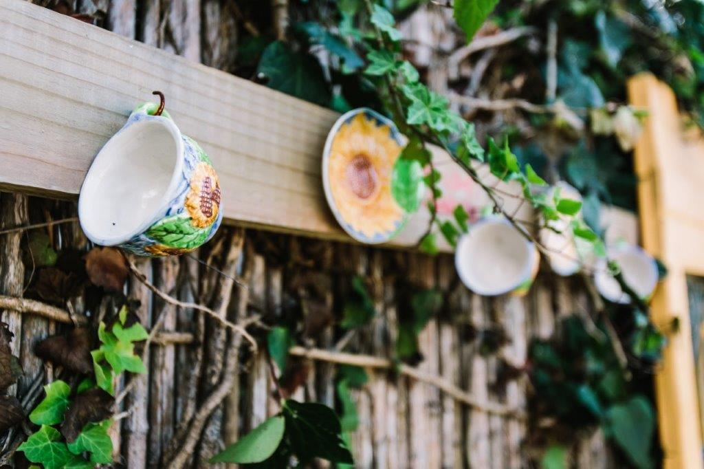 fence with porcelain cup